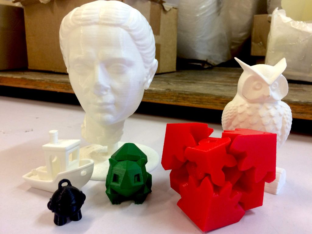 A selection of FDM/FF 3D printed objects, including (left to right) 3D Benchy, 3D Hubs' Marvin and Flowalistik's low-poly Bulbasaur. Photo by Beau Jackson