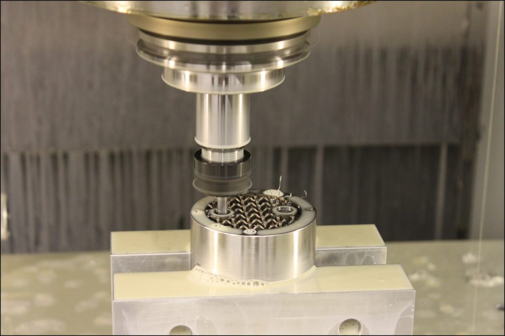 Machining special SAE threads into the fluid ports of a metal AM component. The special threads were required to withstand the extreme pressure this component will see in its final application.