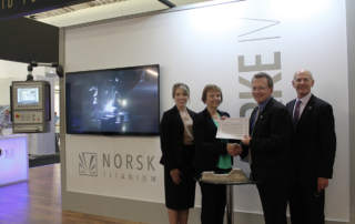 The New York purchase agreement signing. Photo via Norsk Titanium.