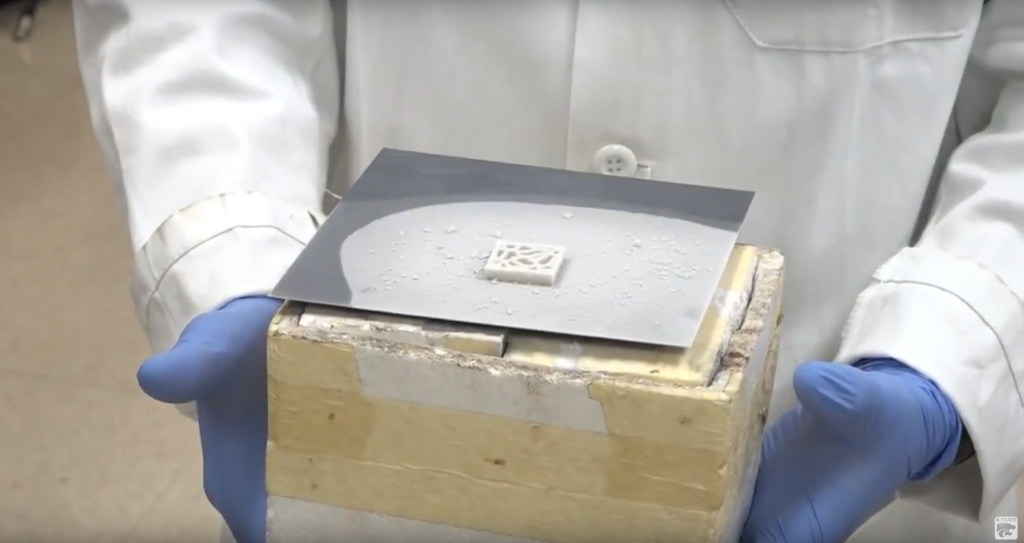 A sample of the 3D graphene aerogel out of the deep freeze. Screenshot via K-State on YouTube