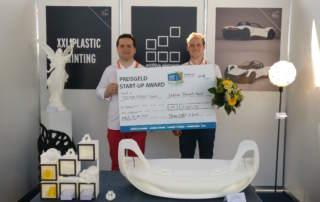 Additive Elements' Johannes Günther (Senior developer) and Thilo Kramer (CEO & CO-Founder) accepting the Messe Erfurt Start-up Award. Photo via Additive Elements.