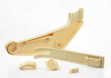 Brackets 3D printed on the Fortus 900mc Production 3D Printer. Image via Stratasys.