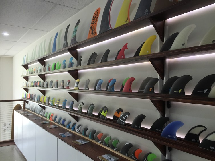 A range of commercially available surfboard fins in a dedicated shop. Photo by Marc in het Panhuis