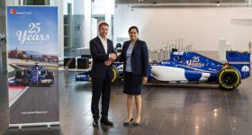 Additive Industries CEO Daan Kersten shaking hands with Team Principal Monisha Kaltenborn. Photo via Additive Industries.