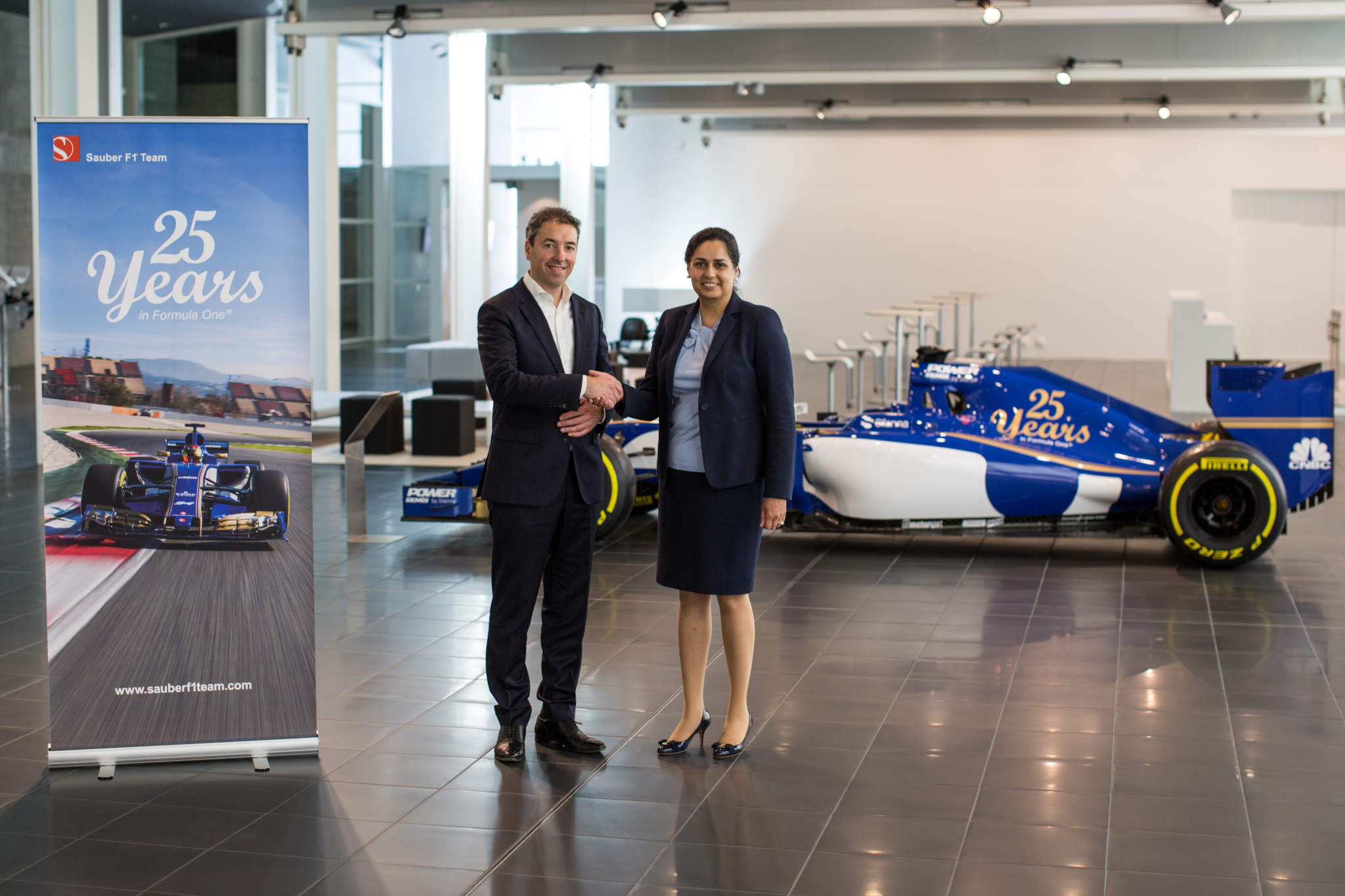 Additive Industries CEO Daan Kersten shaking hands with Team Principal Monisha Kaltenborn. Photo via Additive Industries.