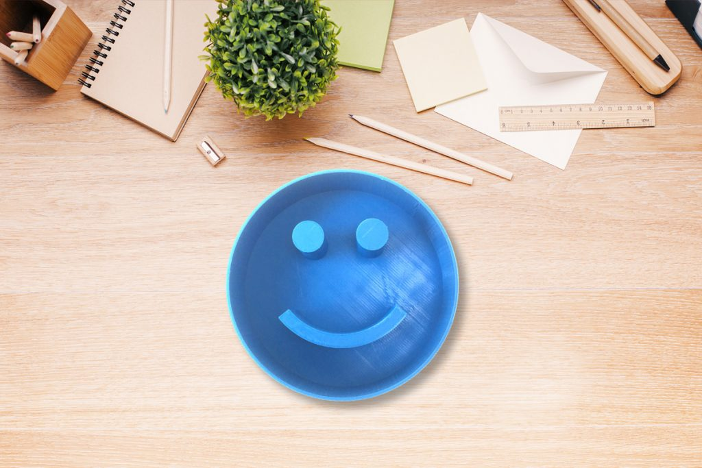 A CAD modeled and 3D printer smiley face cookie cutter. Photo via PrintLab