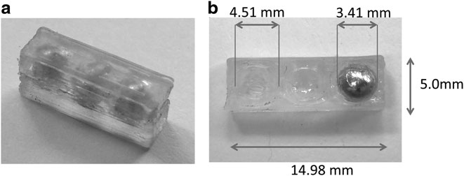 The LRM cell 3D printed as a multimaterial test. (a) shows the cores enclosed by resin, and (b) shows the interior of the LRM with 3D printed silicone and a single metal core. Image via 3D Printing and Additive Manufacturing journal vol. 4 issue 2