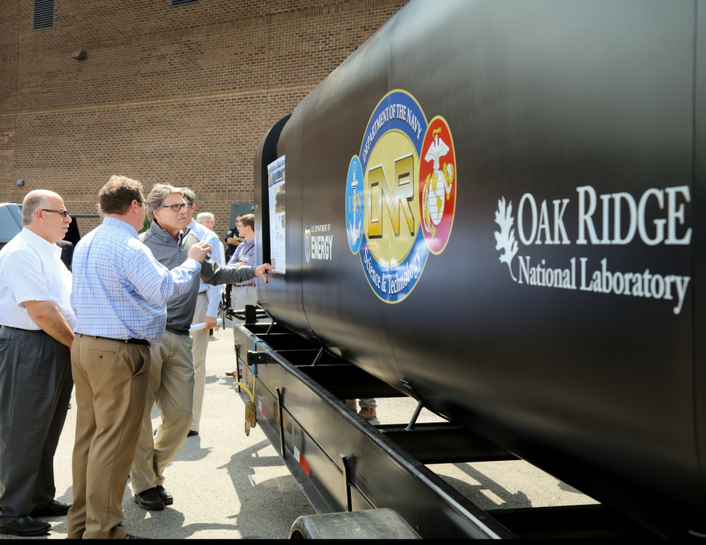 U.S. Department of Energy Secretary Rick Perry views the 3D printed proof-of-concept hull for the Optionally Manned Technology Demonstrator (OMTD). (Photo courtesy of Oak Ridge National Laboratory, Department of Energy