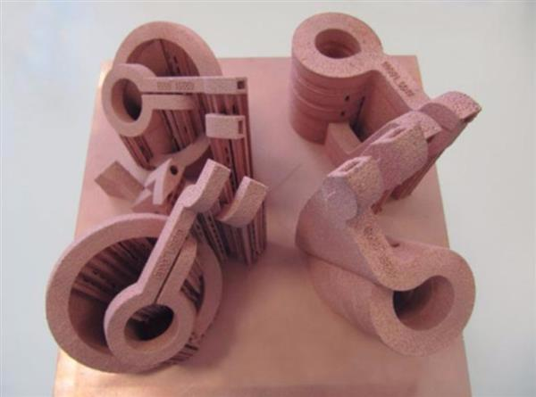 Some of the early copper 3D printed coils. Image via GH Induction.