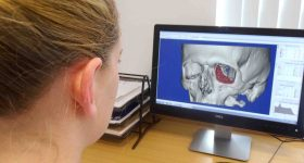 Heather Goodrum working on a 3D cranial model. Photo via Abertawe Bro Morgannwg University Health Board.
