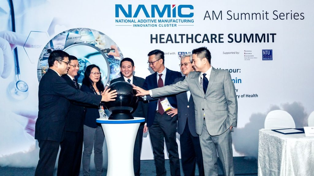 NAMIC officials at the opening of the new AM.NUS center. Photo via NAMIC