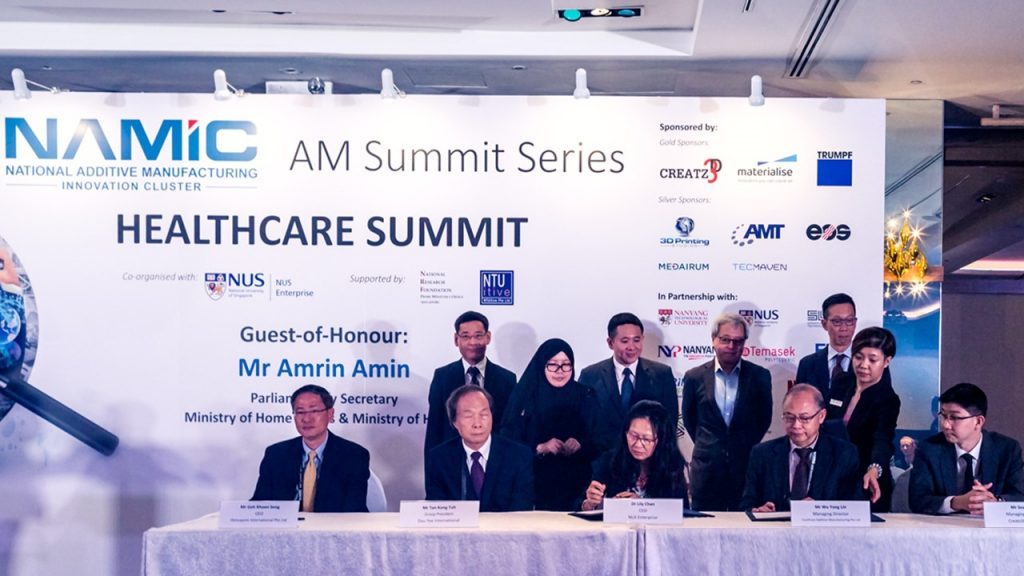 MOU signing at the NAMIC Healthcare Summit. Photo via NAMIC