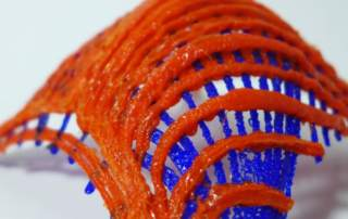 A self-supporting gridshell structure 3D printed by a KUKA robotic arm. Photo via Digital Structures/MIT
