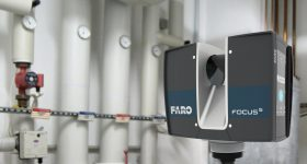 The FARO Focus S 70 Laser Scanner is positioned to scan a mechanical room. Photo via FARO.