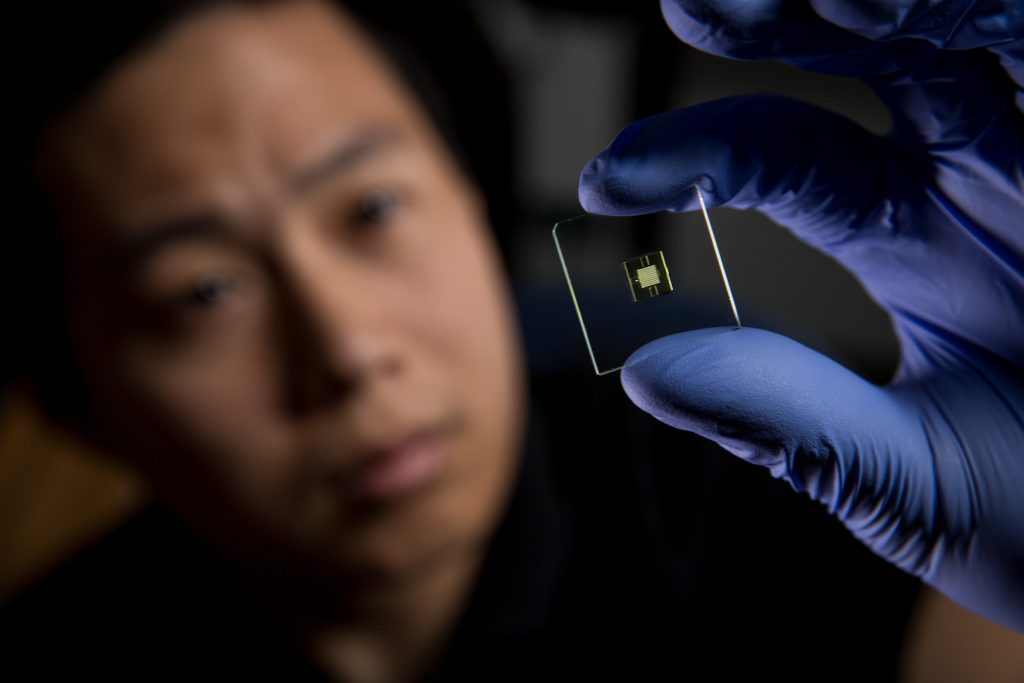 PhD student Hua Gong holds the BYU 3D printed microfluidic device. Photo by Jaren Wilkey/BYU © BYU PHOTO 2017