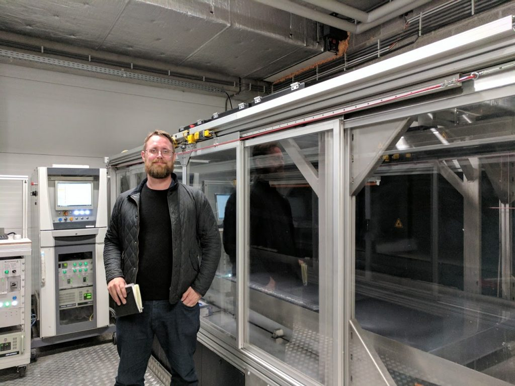 A Materialise Mammoth 3D printer (Editor-in-chief Michael Petch for scale)