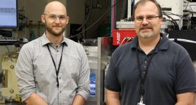 Brandon Lane (left) and Steve Grantham (right) in front of the AMMT/TEMPS system.