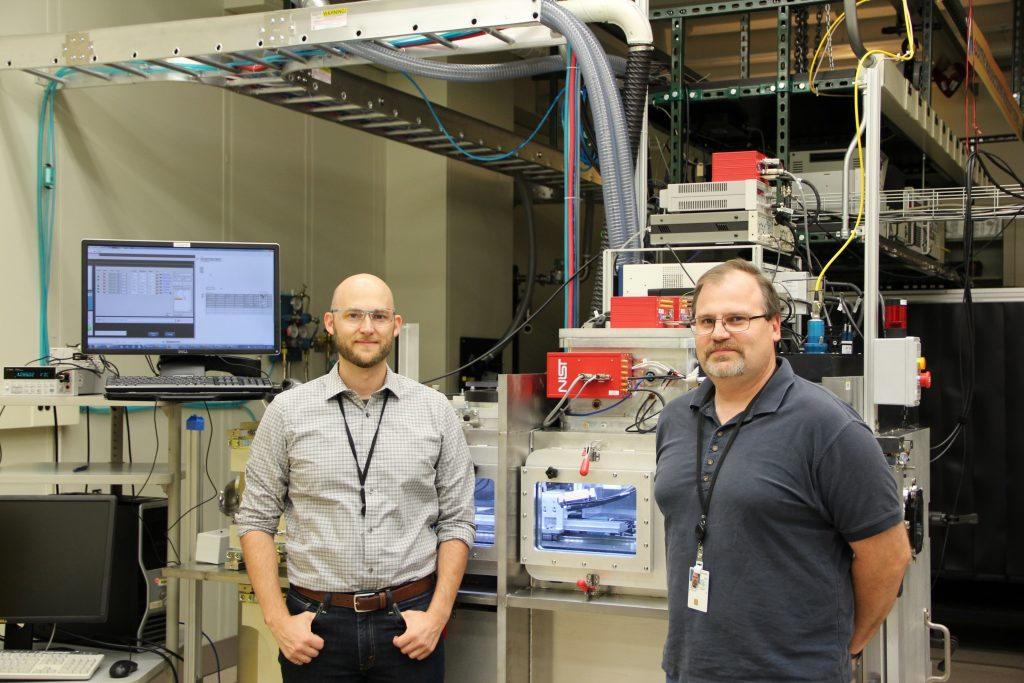 Brandon Lane (left) and Steve Grantham (right) in front of the NIST AMMT/TEMPS system.