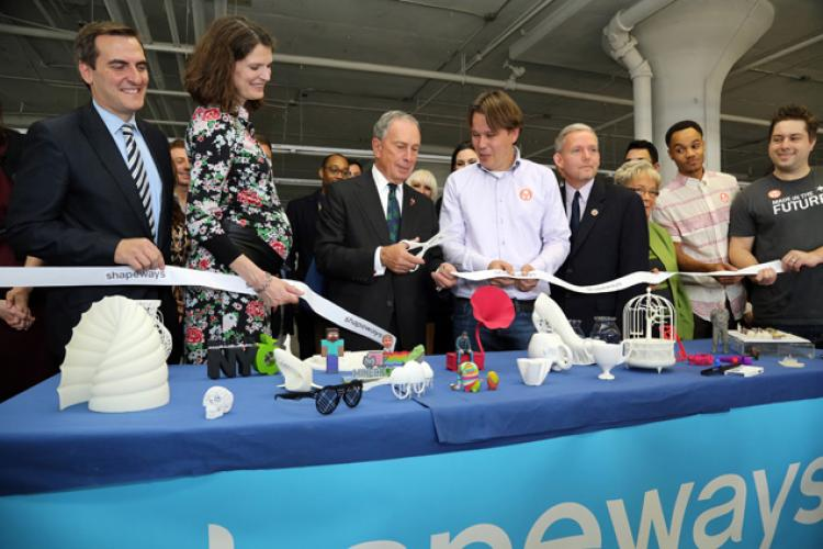 Former NYC Mayor Michael Bloomberg with Peter Weijmarshausen during ribbon cutting of Long Island City facility.