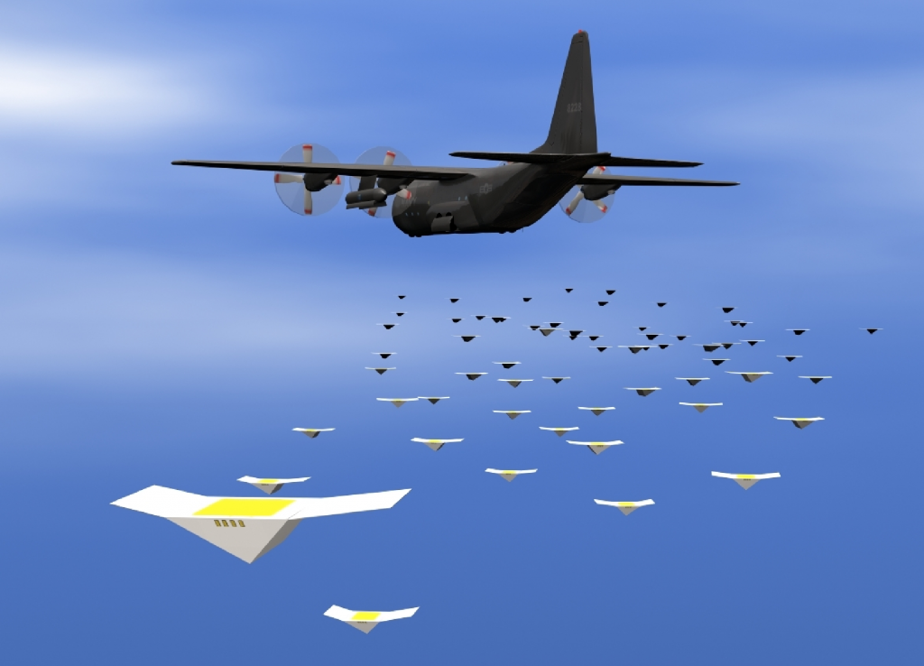 Artist's impressions of a swarm of CICADAs deployed from a Navy aircraft. Image via NRL
