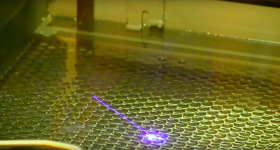 UV Laser fired on to pre-ceramic resin during stereolithography. Image via Youtube/HRL labs