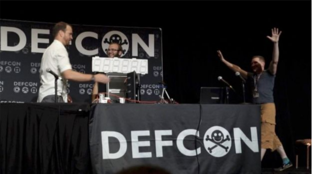 The SparkFun team opening a safe at DEF CON.