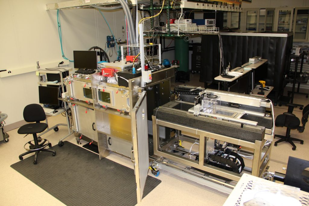 View of the AMMT/TEMPS system with the main carriage (right) pulled out of the chamber (left). This unique design allows experiments and measurements to be set up outside.