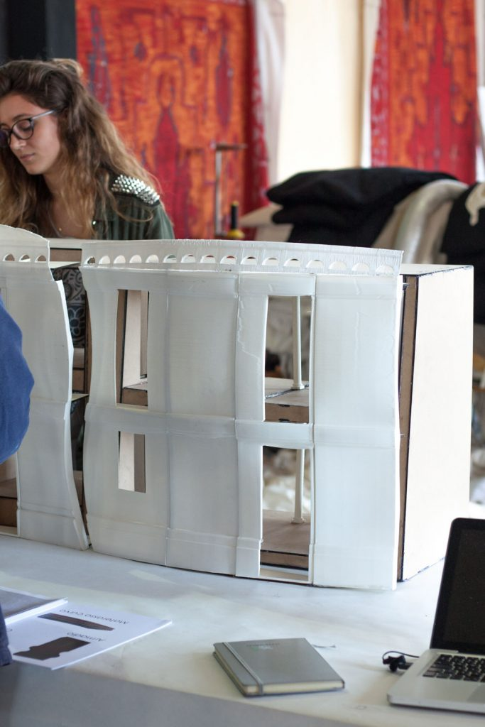 Scaled model of warping Fra Diavolo facades used at the Teatro dell'Opera di Roma. Photo via WASProject