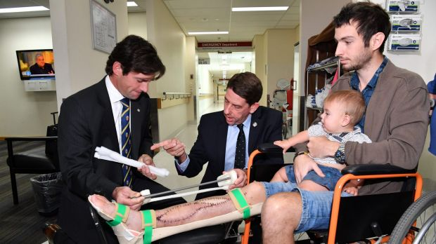 Dr Michael Wagels and Queensland Health Minister Cameron Dick discuss the options at Princess Alexandra Hospital. Photo via The Sydney Morning Herald