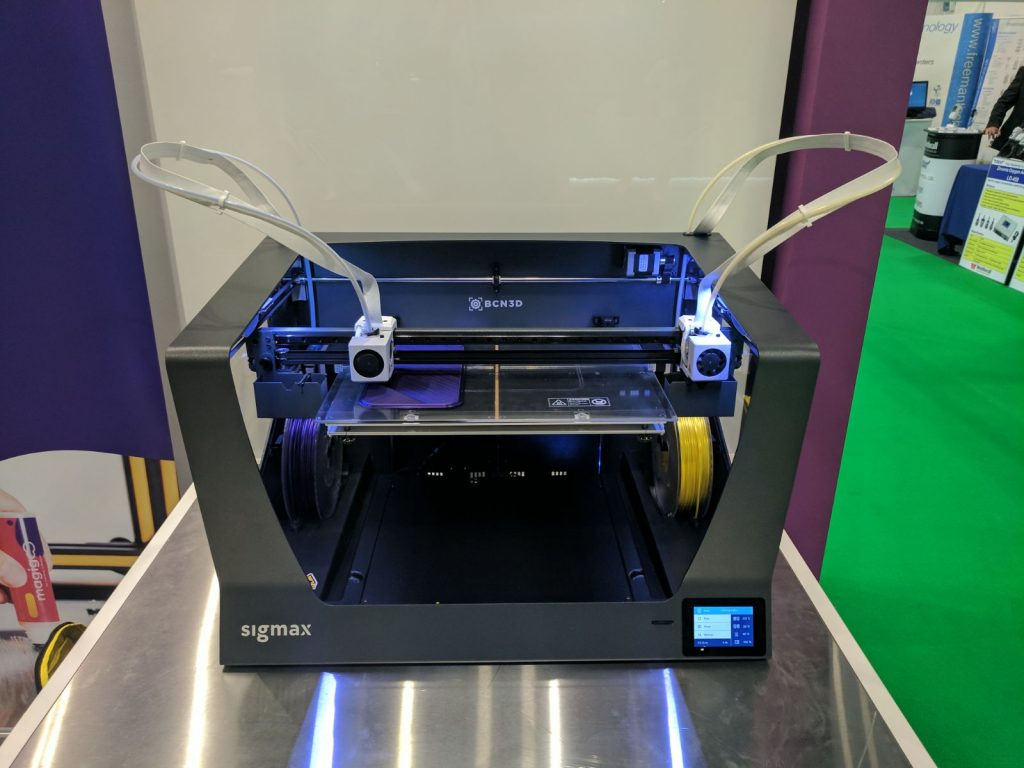 Dual extruders prepare to print either side of the BCN3D Sigmax at TCT 2017. Photo by Michael Petch for 3D Printing Industry