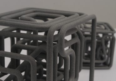 An SLS 3D printed labyrinth cube made from CRP Group Windform powder. Photo via CRP Group Direct Digital Manufacturing on Flickr