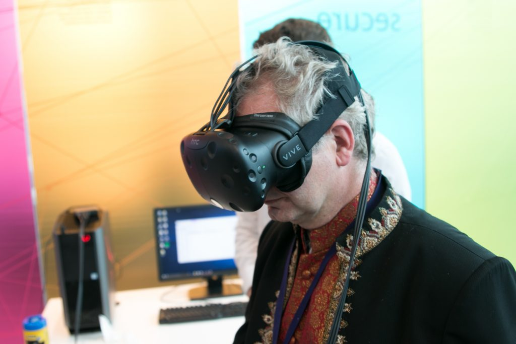 A visitor tries on one of Instrom's VR headsets. Photo via NPL.