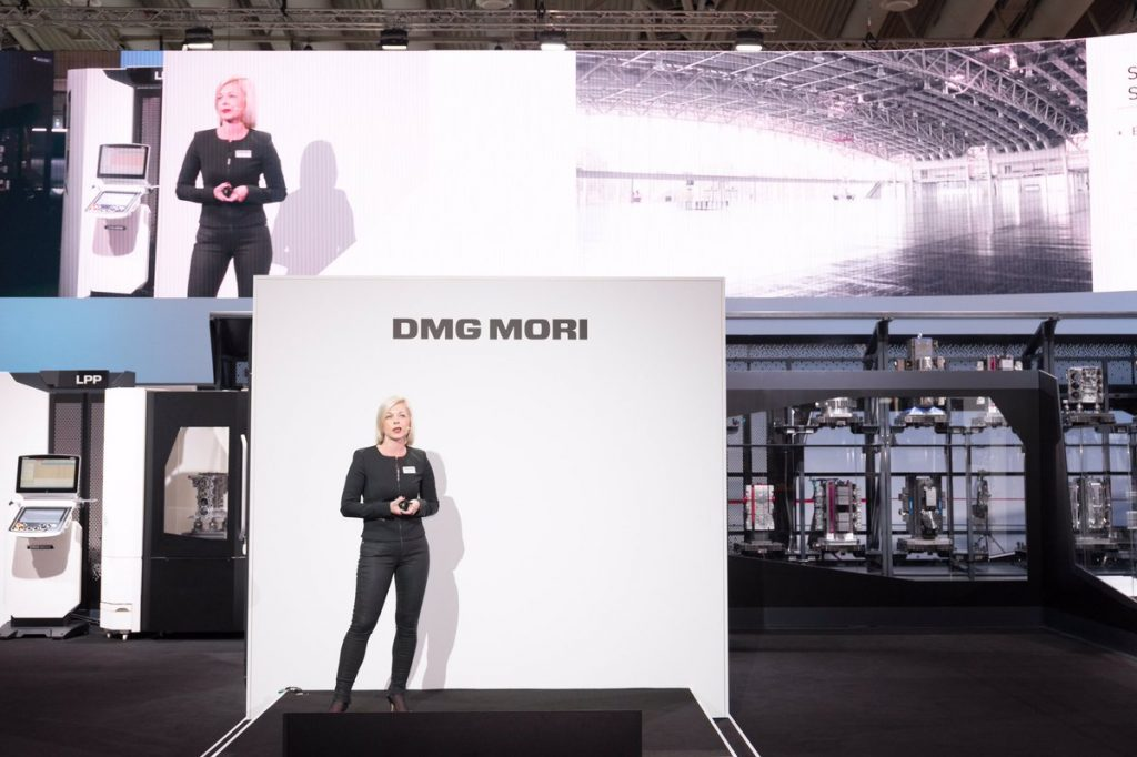 Irene Bader, Director of Global Marketing at DMG MORI Co. Ltd. opens the company booth at EMO 2017. Photo via Irene Bader