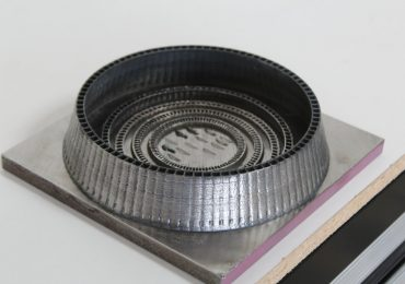 A metal component printed by a Formalloy LDM printer. Photo via Formalloy.
