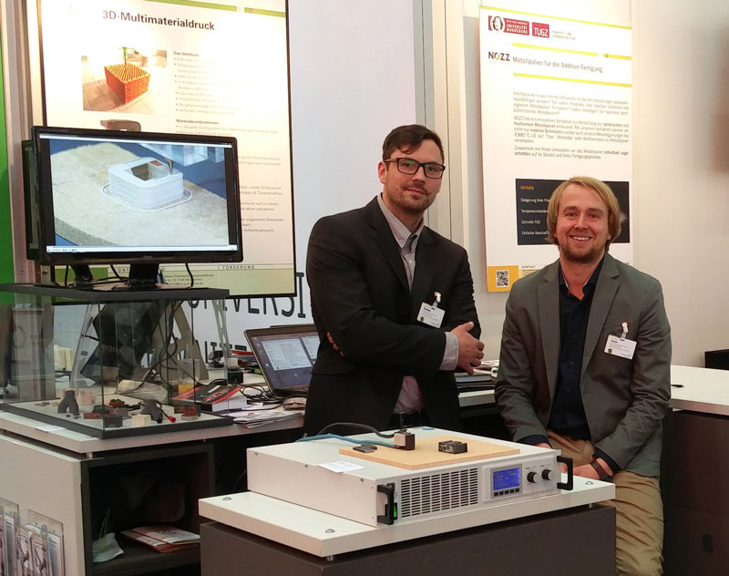Johannes Rudolph and Fabian Lorenz of TU Chemnitz with their 3D printed electric motor. Photo via ViscoTec