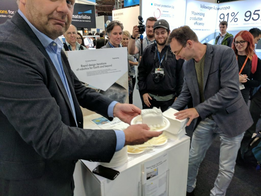 Siert Wijnia (right) founder of Ultimaker cuts the cake celebrating 1 million CUra users at TCT 2017. Photo by Michael Petch for 3D Printing Industry