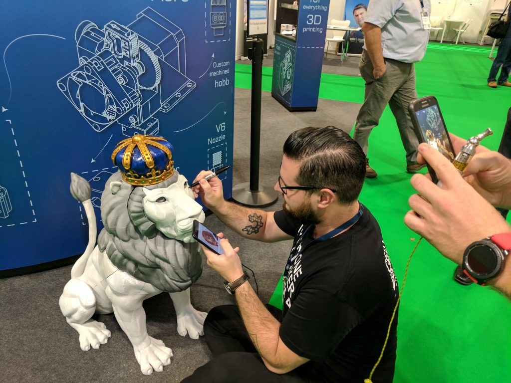Josef Prusa and Loubie's Lion at the E3D Online booth. Photo by Michael Petch.