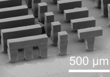 The Langer Lab at MIT has development a new photolithographic method for 3D printing vaccine microparticles. SEM image of a microscopic MIT logo via the Langer Lab.