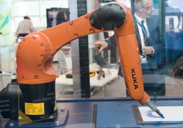 Strathclyde University's Eric Robot drawing the author's face. Photo via NPL.