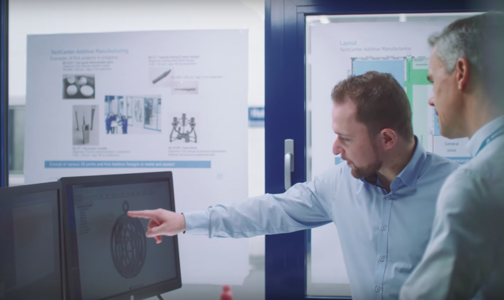 Team members use CAD to visualise the products before printing. Photo via Youtube/Thyussenkrupp.