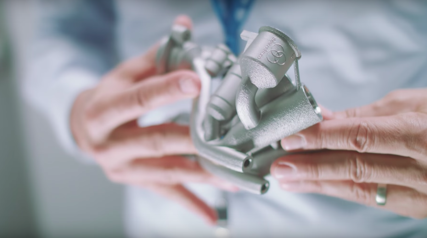 A metal 3D printed engine part printed by Thyssenkrupp. Photo via Youtube/Thyussenkrupp.