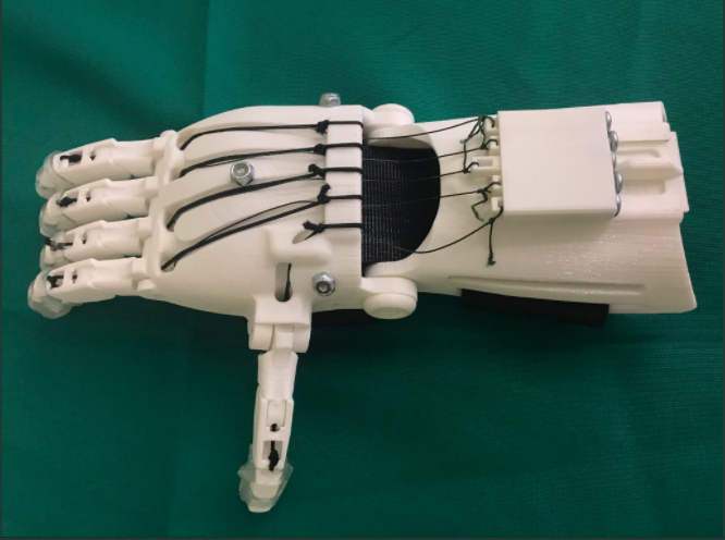 A prosthetic hand assembled by the Girl Scouts in Austin. Photo via Twitter/Adam J Penna.
