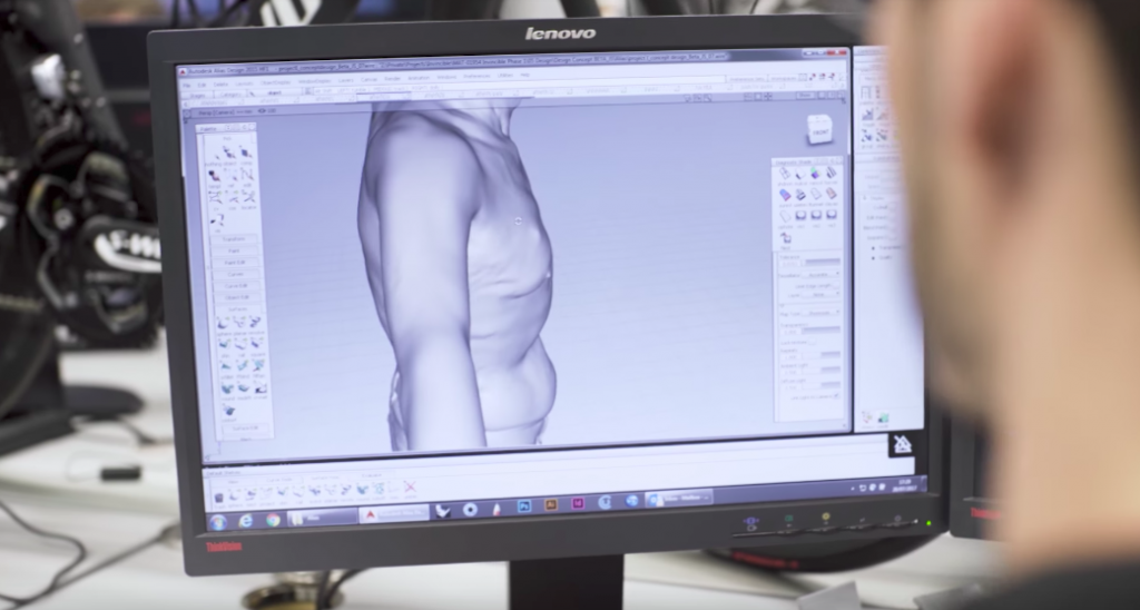 The team using CAD to transform a scan into a prototype. Photo via Youtube/Maclaren Applied Technologies