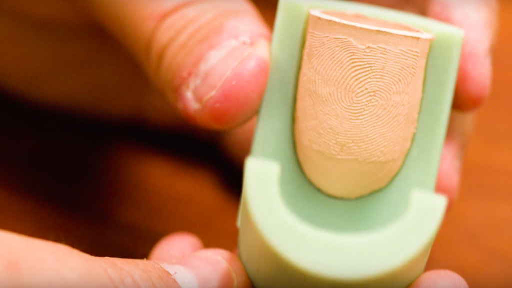 The 3D printed bolds open up to reveal a fingerprint cast. Photo via Youtube/MSU.