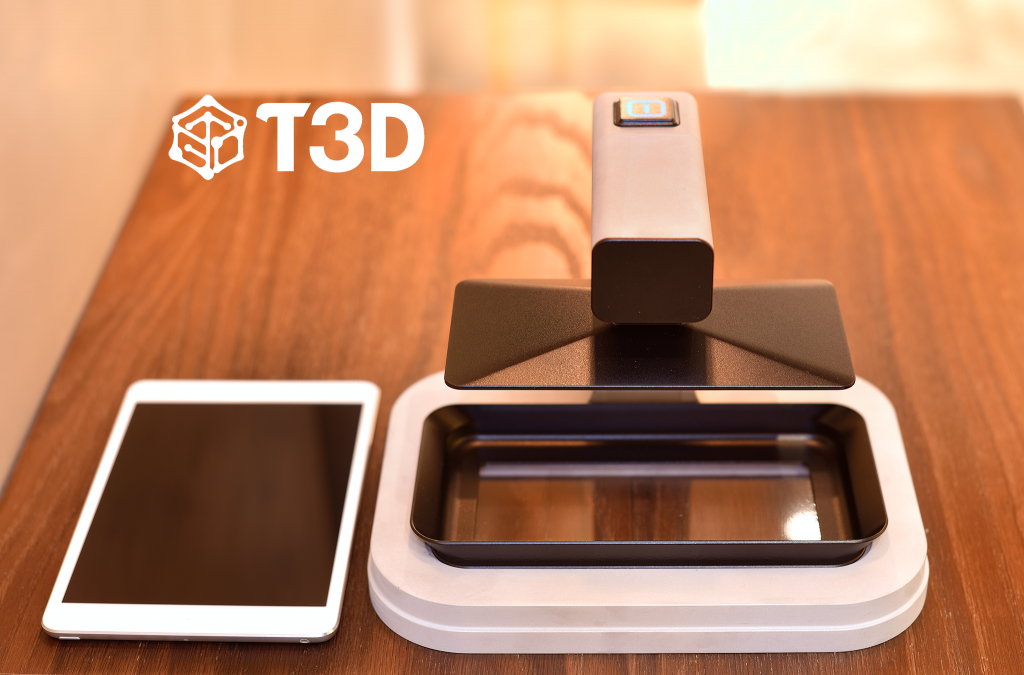 With the T3D printer, users already own half of the machine at home either as a cell phone or a tablet. Photo of the current machine prototype via T3D