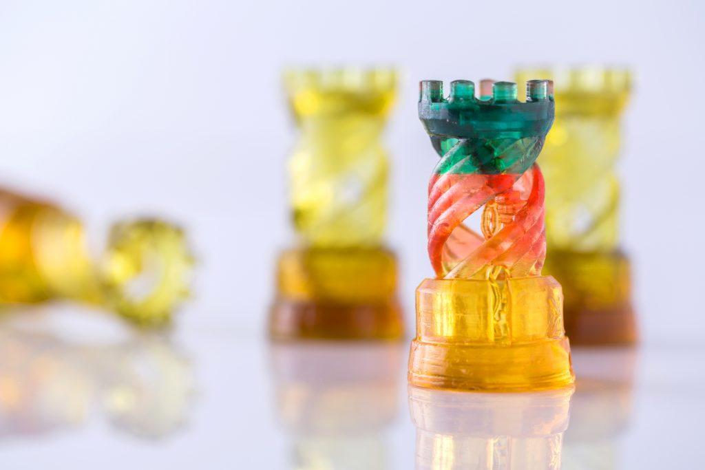 SLA 3D printing in technicolor. Photo via T3D