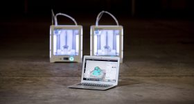 Ultimaker 3D printers driven by Cura slicing and daisychaining software. Photo via Ultimaker
