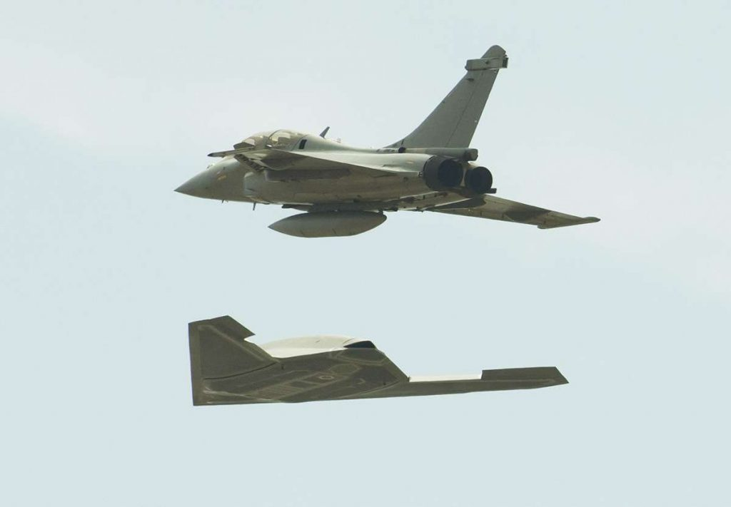 A DARPA Unmanned Combat Aerial Vehicle (UCAV) accompanied by a Dassault Rafale fighter jet. Photo via AP Images