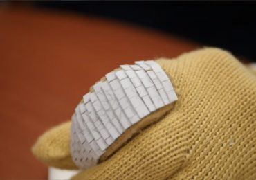 Ceramic scales on a Kevlar glove inspired by gar fish. Screen grab via McGill University on YouTube