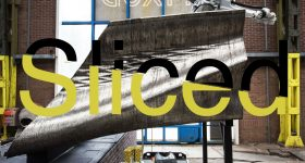 Sliced logo over a robotic arm 3D printing Amsterdam's metal bridge. Original photo via MX3D